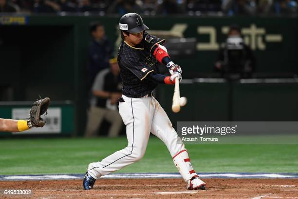 Designated hitter Tetsuto Yamada of Japan flies out in the top of the eighth inning during the World Baseball Classic Pool B Game Three between Japan...