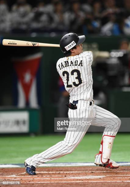 Designated hitter Tetsuto Yamada of Japan hits a solo homer in the bottom of the first inning during the World Baseball Classic Pool E Game Four...
