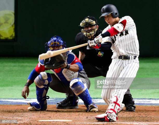 Designated hitter Tetsuto Yamada of Japan hits a two run homer in the bottom of the eighth inning during the World Baseball Classic Pool E Game Four...