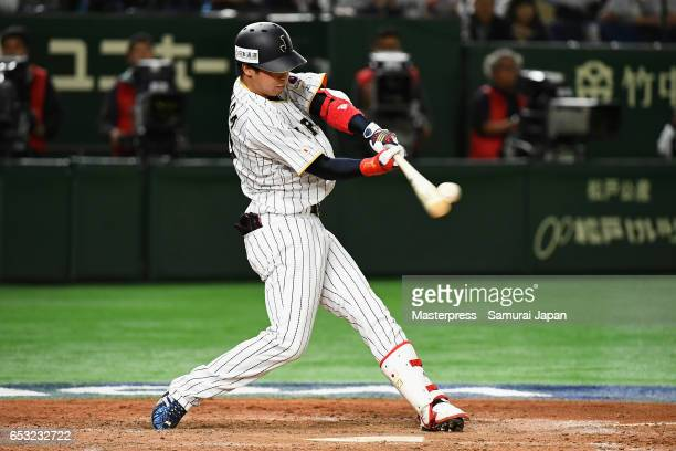 Designated hitter Tetsuto Yamada of Japan hits a two run homer to make it 58 in the bottom of the eighth inning during the World Baseball Classic...