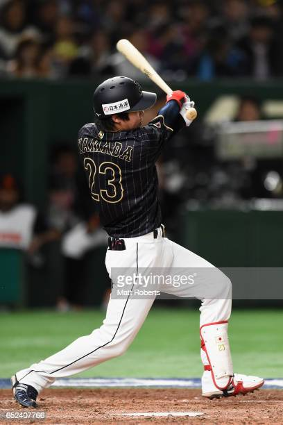 Designated hitter Tetsuto Yamada of Japan singles in the top of the third inning during the World Baseball Classic Pool E Game Two between Japan and...