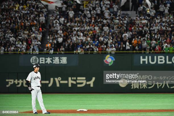 Designated hitter Tetsuto Yamada of Japan waits for the umpires' decision after hitting a RBI double in the bottom of the fourth inning during the...