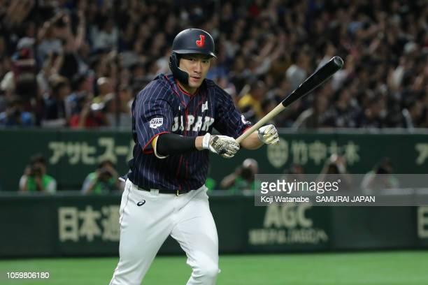 Designated hitter Yuki Yanagita of Japan celebrates hitting a two-run home run in the top of 3rd inning to make it 5-0 during the game two of the...