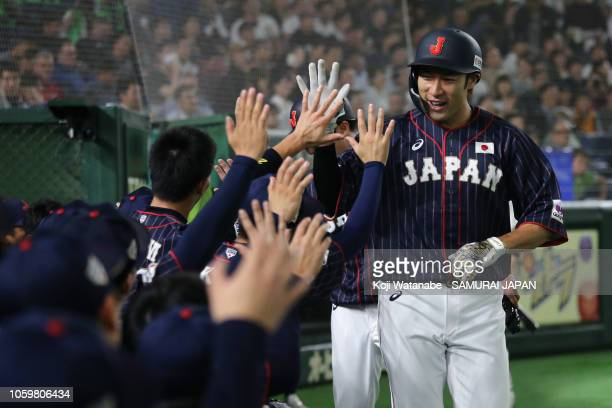 Designated hitter Yuki Yanagita of Japan celebrates hitting a tworun home run in the top of 3rd inning to make it 50 during the game two of the Japan...