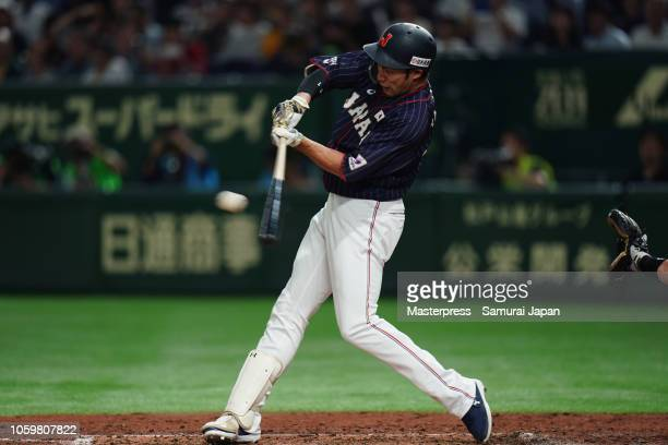 Designated hitter Yuki Yanagita of Japan hits a RBI single to make it 6-0 in the top of 5th inning during the game two of the Japan and MLB All Stars...