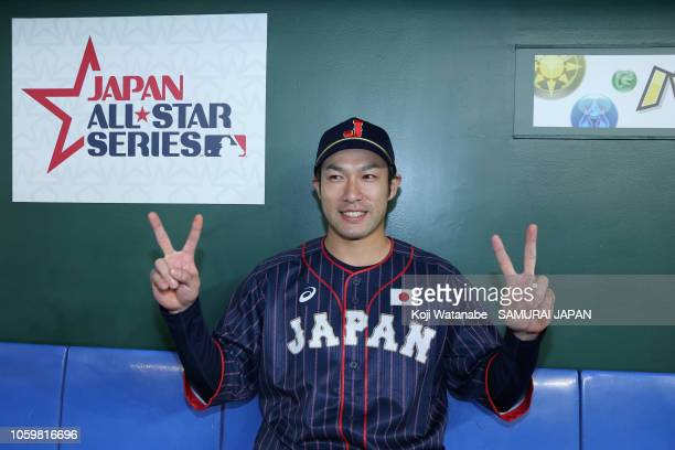Designated hitter Yuki Yanagita of Japan poses for photographs after his team's 126 victory in the game two of the Japan and MLB All Stars at Tokyo...