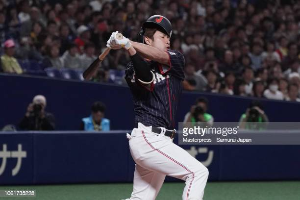 Designated hitter Yuki Yanagita of Japan strikes out in the top of 2nd inning during the game six between Japan and MLB All Stars at Nagoya Dome on...