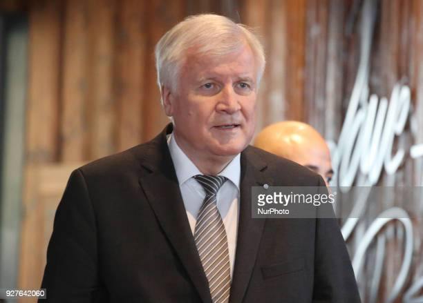 Designated minister of interiour and home affairs and chairman of the CSU Horst Seehofer enters the press conference in Munich Germany on 5 March...