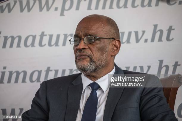 Designated Prime Minister Ariel Henry looks on during a ceremony at La Primature in Port-au-Prince, Haiti, on July 20, 2021. - The ceremony comes as...