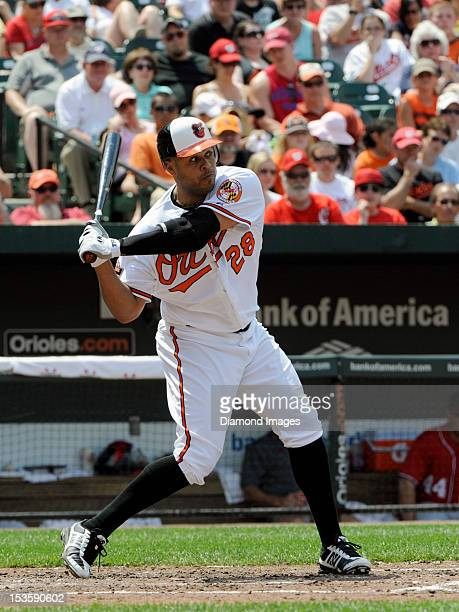 Designatedhitter Ronnie Paulino of the Baltimore Orioles strides into a pitch during the bottom of the fourth inning of an interleague game on June...