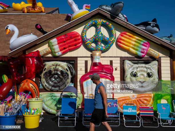Designed air mattresses and float tubes are displayed at the Seaberry Surf Gift Store in Wellfleet, Massachusetts, July 21, 2019.