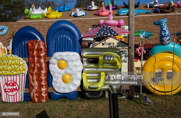 Designed air mattresses and float tubes are displayed at the Seaberry Surf Gift Store in Wellfleet Massachusetts July 21 2017 The Cape Cod store...
