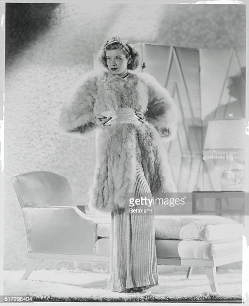 Designed by Renie for Lucille Ball to wear in The Joy of Living this sophisticated lounging ensemble consists of a collarless tunic of soft marabou...