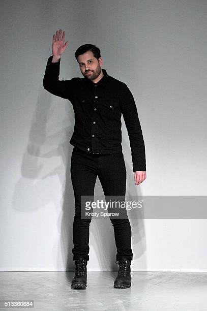 Designer Adam Andrascik acknowledges the audience during the Guy Laroche show as part of Paris Fashion Week Womenswear Fall/Winter 2016/2017 on March...
