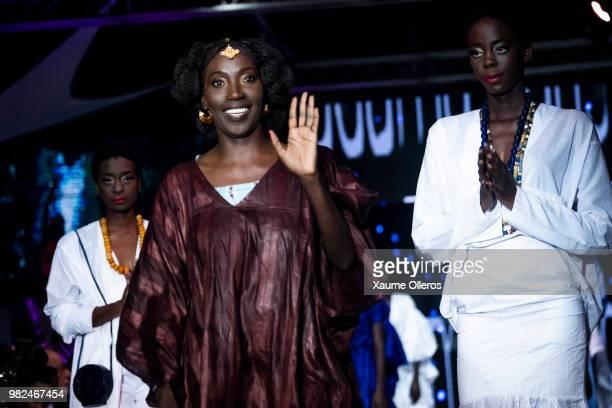 Designer Adama Paris greets the crowd after her show at the 16th Dakar Fashion Week at Radison Blu Hotel on June 23, 2018 in Dakar, Senegal.