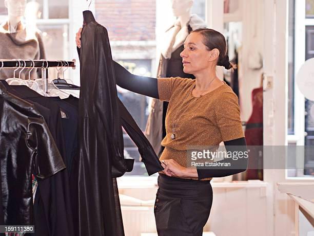 Designer admires garment in store