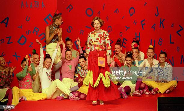 Designer Agatha Ruiz de la Prada walks on the runway as her models applaud February 17, 2001 after her Fall/Winter 2001 fashion show on the first day...