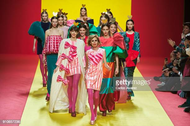 Designer Agatha Ruiz De La Prada walks the runway at the end of the Agatha Ruiz De La Prada fashion show during the Mercedes Benz Fashion Week...