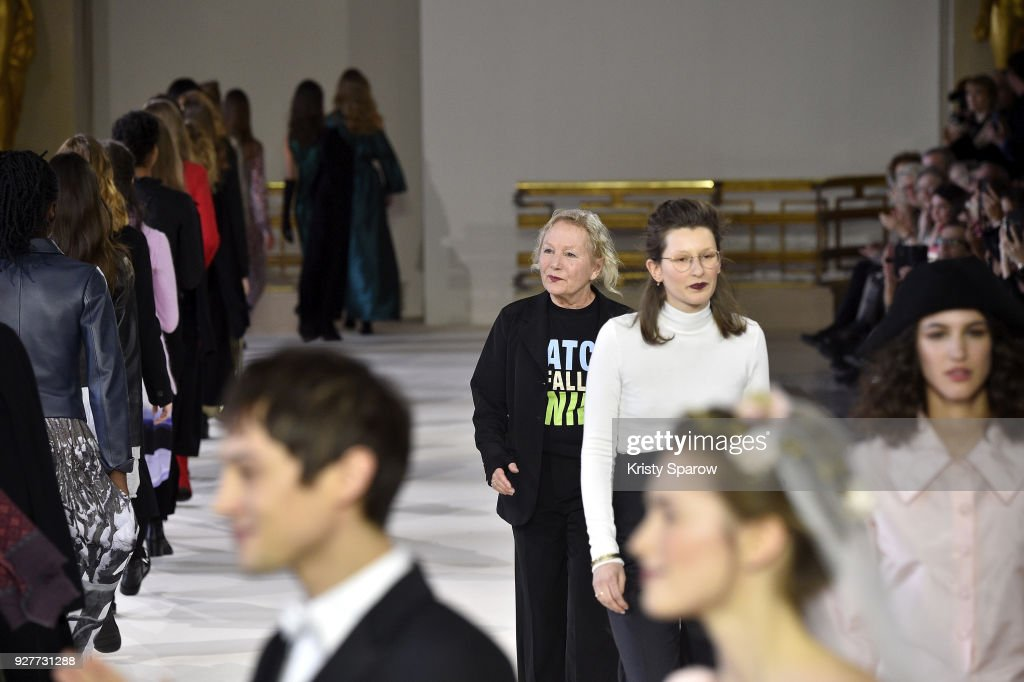 Designer Agnes B acknowledges the audience during the Agnes B show as part of the Paris Fashion Week Womenswear Fall/Winter 2018/2019 on March 5, 2018 in Paris, France.