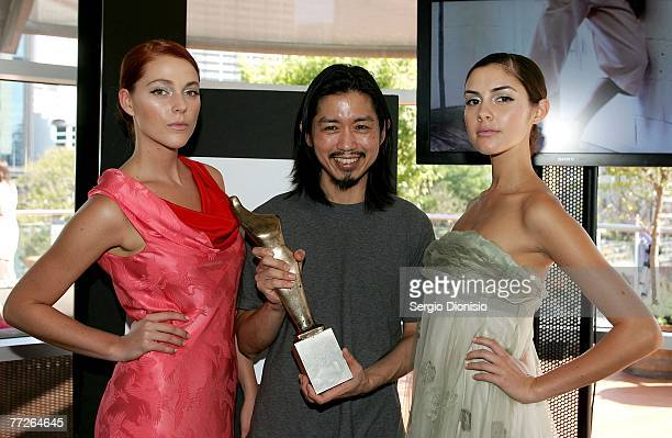 Designer Akira Isogawa accepts his Australian Fashion Laureate statuette following the announcement of his win by the Premier of NSW Morris Iemma on...