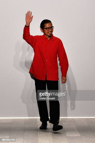 Designer Akira Isogawa thanks the audience following the Akira show at MercedesBenz Fashion Week Resort 18 Collections at Carriageworks on May 18...