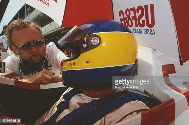 Designer Alan Jenkins talks to Michele Alboreto of Italy as he sits aboard the Footwork Arrows Racing Arrows A11B Cosworth V8 during practice for the...