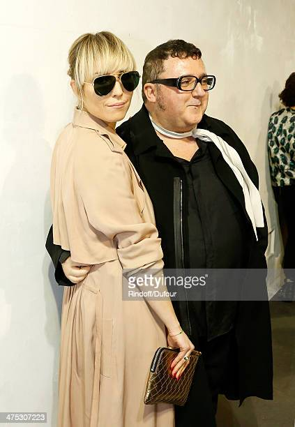 Designer Alber Elbaz and actress Noomi Rapace attend the Lanvin show as part of the Paris Fashion Week Womenswear Fall/Winter 20142015 on February 27...