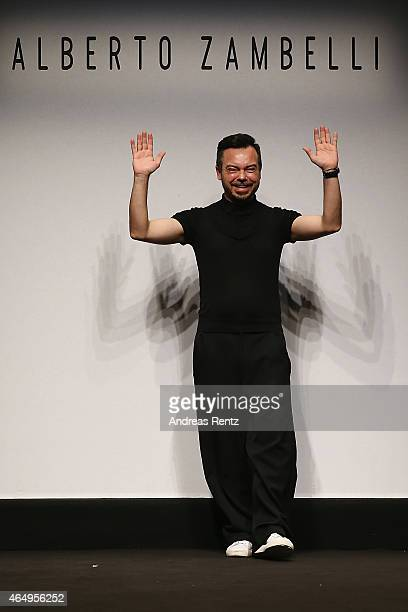 Designer Albero Zambelli acknowledges the applause of the audience at the Alberto Zambelli show during the Milan Fashion Week Autumn/Winter 2015 on...