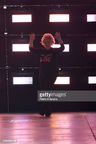 Designer Alberta Ferretti acknowledges the applause of the audience at the runway at the Alberta Ferretti show during Milan Fashion Week...