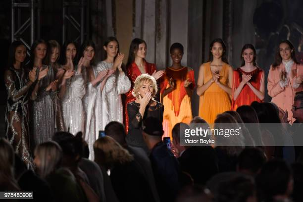 Designer Alberta Ferretti acknowledges the applause of the audience at the runway at the Alberta Ferretti show during Milan Men's Fashion Week...