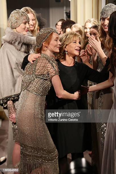 Designer Alberta Ferretti acknowledges the applause of the models after the 'Alberta Ferretti Special Event' during the Milan Fashion Week...
