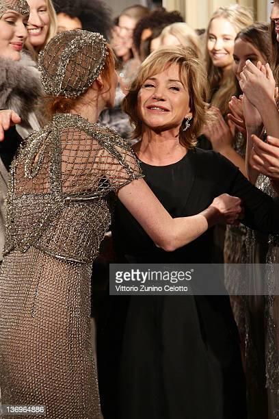 Designer Alberta Ferretti acknowledges the applause of the models after the 'Alberta Ferretti Special Event' during the Milan Fashion Week...