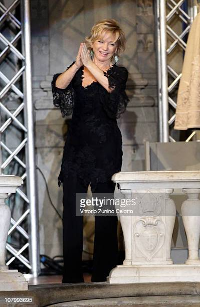 Designer Alberta Ferretti acknowledges the applause of the public after the Alberta Ferretti fashion show during Pitti Immagine Uomo 79 on January 11...