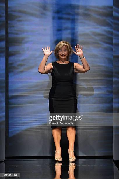 Designer Alberta Ferretti acknowledges the applause of the public after the Alberta Ferretti Spring/Summer 2013 fashion show as part of Milan...