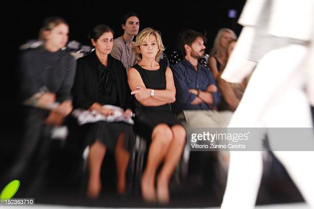 Designer Alberta Ferretti looks at models practice walking the runway before the Alberta Ferretti fashion show as part of Milan Fashion Week...