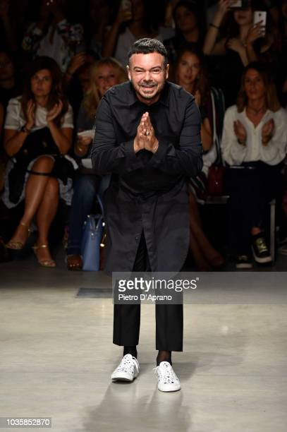 Designer Alberto Zambelli acknowledges the applause of the audience after his show during Milan Fashion Week Spring/Summer 2019 on September 19 2018...