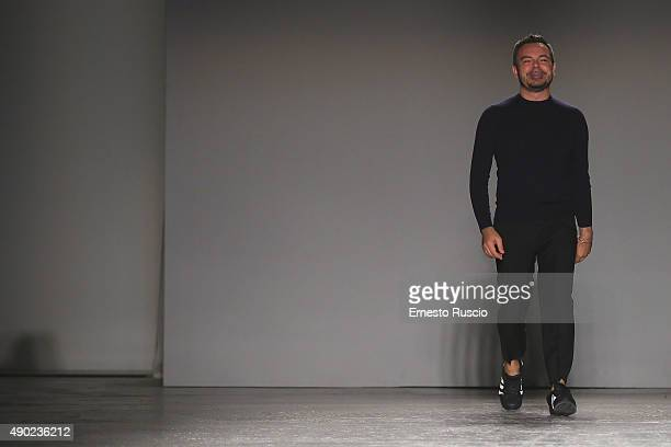 Designer Alberto Zambelli acknowledges the applause of the audience at the Alberto Zambelli fashion show as part of Milan Fashion Week Spring/Summer...