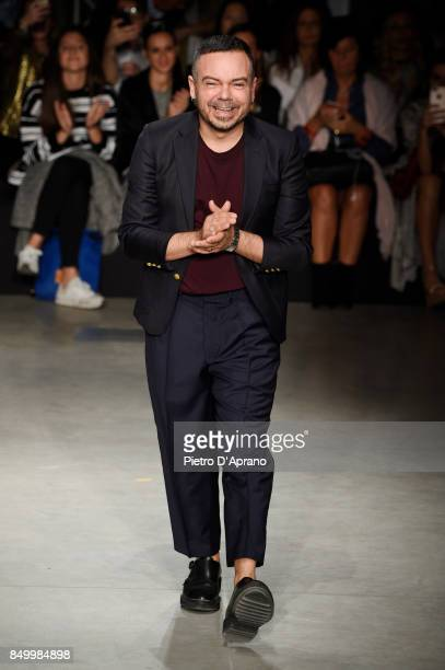 Designer Alberto Zambelli acknowledges the applause of the audience at the Alberto Zambelli show during Milan Fashion Week Spring/Summer 2018 on...