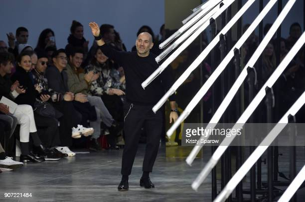 Designer Aldo Maria Camillo acknowledges the audience during the Cerruti 1881 Menswear Fall/Winter 20182019 show as part of Paris Fashion Week on...
