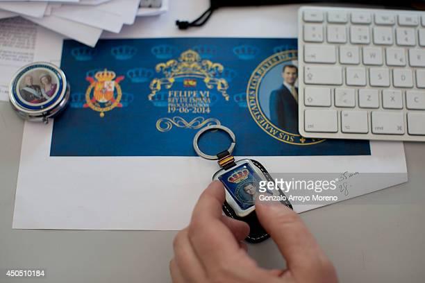 Designer Alejandro checks a keyring style of the Prince Felipe coronation at LK Merchandising Factory on June 12, 2014 in Colmenar Viejo, Spain. LK...