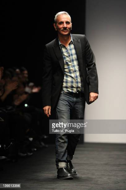 Designer Alessandro dell'Acqua recives appluase after the show at the N 21 Autumn/Winter 2012/2013 fashion show as part of Milan Womenswear Fashion...