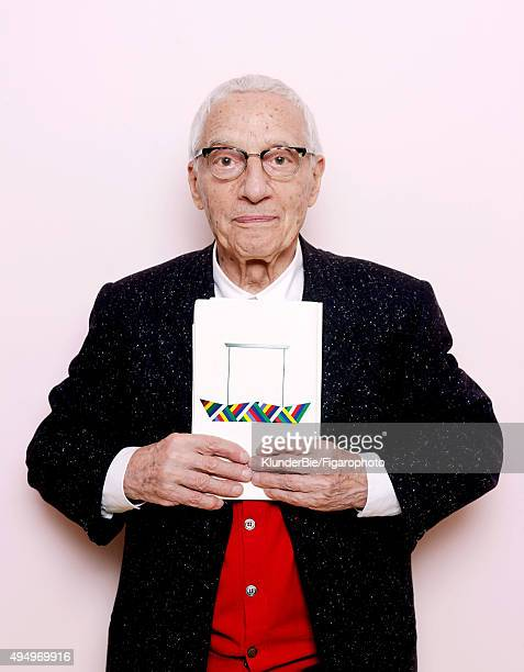 Designer Alessandro Mendini is photographed for Madame Figaro on April 14 2015 in Milan Italy Photographed with a picture of his Dariva light fixture...