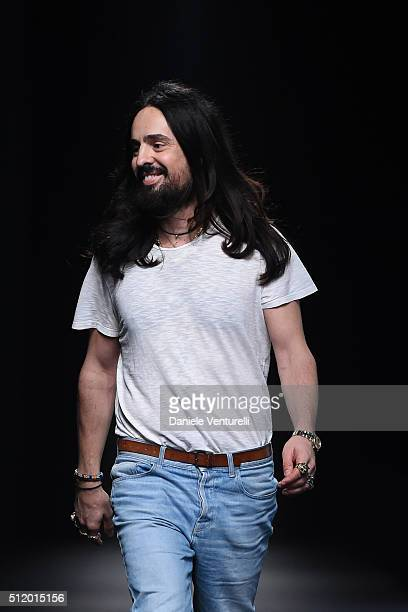 Designer Alessandro Michele acknowledges the applause of the audience after the Gucci show during Milan Fashion Week Fall/Winter 2016/17 on February...