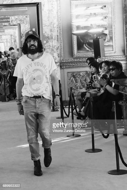 Designer Alessandro Michele acknowledges the applause of the public after the Gucci Cruise 2018 show at Palazzo Pitti on May 29 2017 in Florence Italy