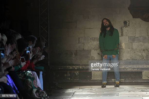 Designer Alessandro Michele aknowledge the applause of the public after thee Gucci Cruise 2017 fashion show at the Cloisters of Westminster Abbey on...