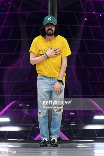 Designer Alessandro Michele aknowledge the applause of the public after the Gucci show during Milan Fashion Week Fall/Winter 2017/18 on February 22...