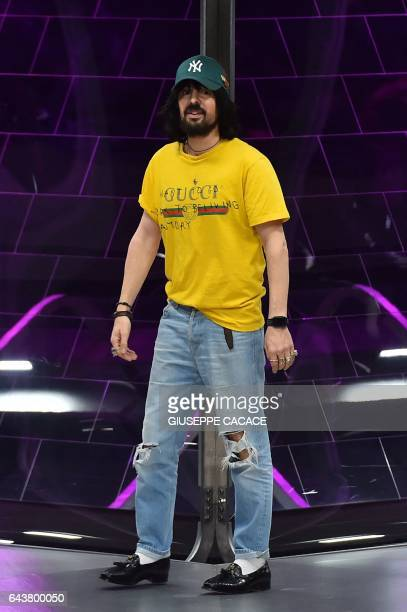 Designer Alessandro Michele greets the audience at the end of the show for fashion house Gucci during the Women's Fall/Winter 2017/2018 fashion week...
