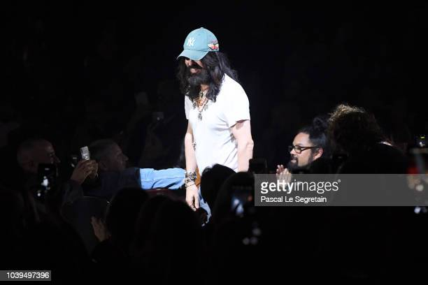 Designer Alessandro Michele greets the crowd at the Gucci show during Paris Fashion Week Spring/Summer 2019 on September 24 2018 in Paris France