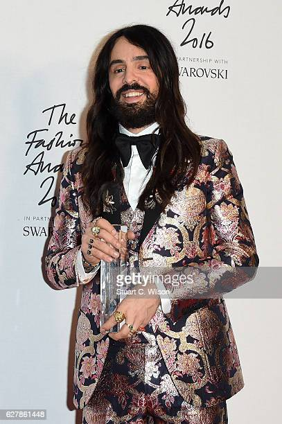 Designer Alessandro Michele poses in the winners room after winning the International Accessories Designer Award at The Fashion Awards 2016 at Royal...