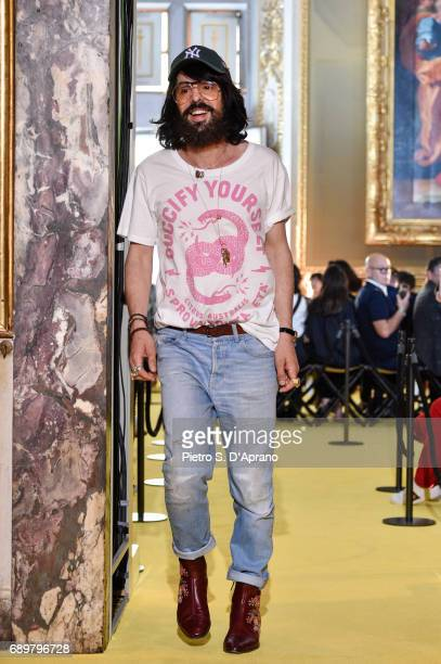 Designer Alessandro Michele walks the runway at the Gucci Cruise 2018 show at Palazzo Pitti on May 29 2017 in Florence Italy